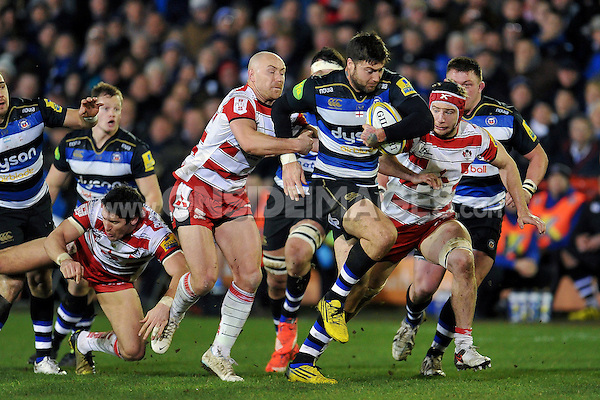 Matt Banahan of Bath Rugby takes on the Gloucester defence. Aviva Premiership match, between Bath Rugby and Gloucester Rugby on February 5, 2016 at the Recreation Ground in Bath, England. Photo by: Patrick Khachfe / Onside Images