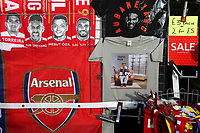 Arsenal merchandise for sale on the market stalls near 'The Emirates' including a T shirt with a Tottenham fan sitting down in an empty Trophy Room during Arsenal vs Rennes, UEFA Europa League Football at the Emirates Stadium on 14th March 2019