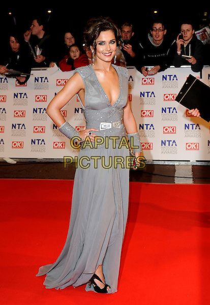 CHERYL COLE .At the National Television Awards, held at O2 Arena, London, England, UK, January 20th 2010..arrivals TV NTA full length long maxi dress sleeveless cuffs wristbands gold clutch bag beaded cleavage low cut shoulder pads  grey gray black shoes peep toe cut out .CAP/FIN.©Steve Finn/Capital Pictures.