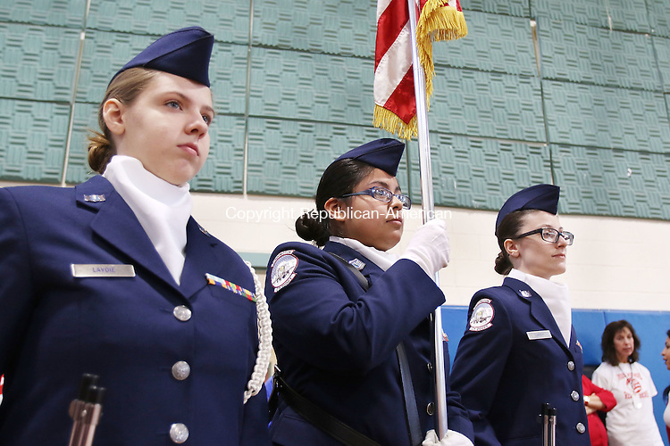 TORRINGTON CT. 14 November 2016-110816SV02-From left, Sage Lavoie, 15, Bianca Tellez, 15, and Christine Libbey, 16,  all of the Air Force Junior ROTC from Torrington High present the American Flag during the annual Veterans Day celebration event at Vogel-Wetmore School in Torrington Monday.<br /> Steven Valenti Republican-American