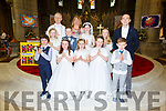 The pupils from Scoil Saidhbhín Cahersiveen who made their First Holy Communion in the Daniel O'Connell Memorial Church in Cahersiveen on Saturday pictured here front l-r; Alex Nassar, Louise O'Connor, Joan O'Mahony, Molly Houlihan, Noah Arthur, back l-r; Leah O'Connor, Sean O'Connor, Skaiste Satinskaite, Eglija Alimaite with Fr Larry Kelly, Nessa Cullinan & Dominic O'Sullivan.