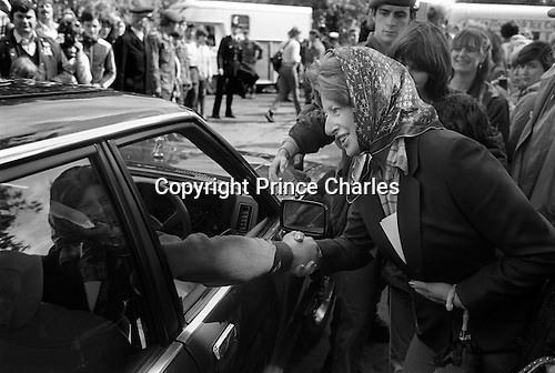 Woman in headscarf shaking the hand of Prince Charles who has been playing Polo at the Ham Polo Club ground Surrey near London UK 1980s...