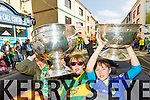 Ciara Wall Jack and Cian Sheehy with the Sam Maguire and the Tommy Markham cups at Tralee Saint Patrick's day parade on Tuesday.