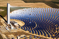The PS10 solar power plant at Sanlucar la Mayor outside Seville. The solar power tower, the first commercial solar tower in the world, run by the Spanish company Solucar (Abengoa), can provide electricity for up to 6,000 homes. 624 heliostats (movable mirrors) concentrate the sun's rays to the top of a 115m high tower where a solar receiver and a steam turbine are located. Solucar (Abengoa) plans to build a total of nine solar towers over the next seven years to provide electricity for an estimated 180,000 homes.