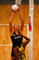 17.1.2014 New Zealand's Irene van Dyk puts up a shot against Jamaica during their netball test match in London, England. Mandatory Photo Credit (Pic: Tim Hales). ©Michael Bradley Photography.
