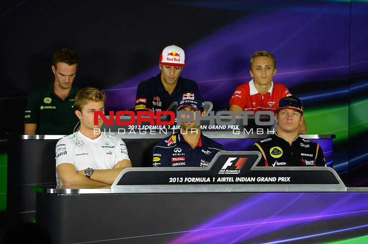 25.-27-10-2013, Jaypee-Circuit, Noida, IND, F1, Grosser Preis von Indien, Noida, im Bild Guido van der Garde (NL), Caterham F1 Racing - Nico Rosberg (GER), Mercedes GP - Daniel Ricciardo (AUS) Scuderia Toro Rosso - Mark Webber (AUS), Red Bull Racing - Max Chilton (GBR), Marussia F1 Team - Kimi Raikkonen (FIN), Lotus Renault F1 Team <br />  Foto &copy; nph / Mathis