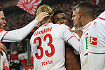 30.11.2019, RheinEnergieStadion, Koeln, GER, 1. FBL, 1.FC Koeln vs. FC Augsburg,<br />  <br /> DFL regulations prohibit any use of photographs as image sequences and/or quasi-video<br /> <br /> im Bild / picture shows: <br /> Torjubel / Jubel / Jubellauf,    Jhon Córdoba (FC Koeln #15),   mit Sebastiaan Bornauw (FC Koeln #33), Simon Terodde (FC Koeln #9), Benno Schmitz (FC Koeln #2), <br /> <br /> Foto © nordphoto / Meuter