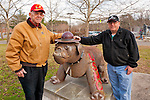 U.S. Marine veterans posing in front of  United States Marine Corps USMC Bulldog statue on grounds of Northport Veterans Affairs Medical Center, in Northport, New York, USA, on December 10, 2011. Merrick Post #1282 of American Legion members, including Robert Tom Riordan, at left, were at the VA medical center to entertain veterans with holiday songs and music.