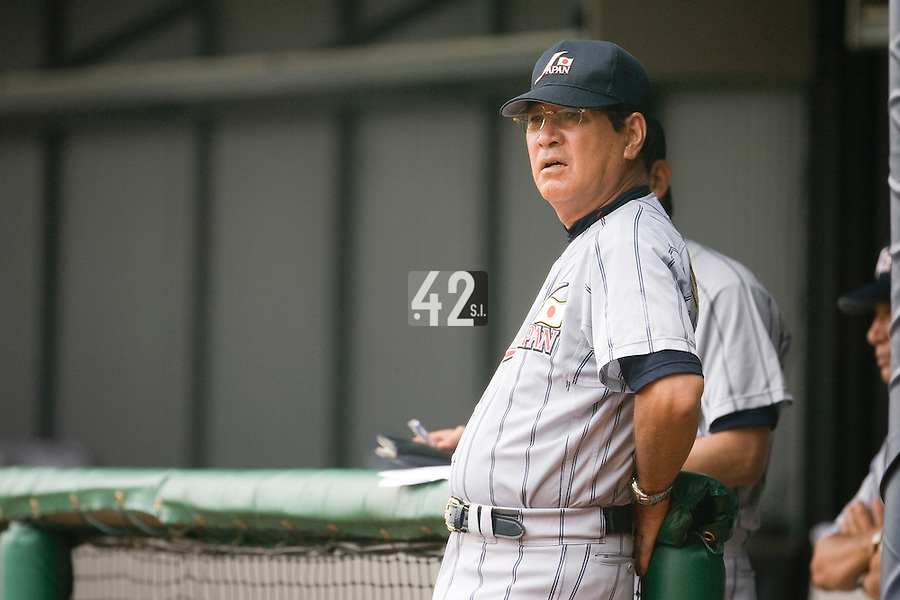 19 August 2007: Coach Koji Yamamoto watchs the game during the Japan 4-3 victory over France in the Good Luck Beijing International baseball tournament (olympic test event) at the Wukesong Baseball Field in Beijing, China.