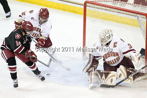 Jillian Dempsey (Harvard - 14), Jessica Martino (BC - 26), Molly Schaus (BC - 30) - The Boston College Eagles defeated the Harvard University Crimson 3-1 to win the 2011 Beanpot championship on Tuesday, February 15, 2011, at Conte Forum in Chestnut Hill, Massachusetts.