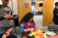 Karonika Brown, 34, (center) makes a paper lantern craft during a Lunar New Year celebration in the Asian American Connections Center at Middlesex Community College in Lowell, Mass., USA, on Thurs., Feb. 15, 2018. Brown graduated with a degree with an Associates Degree in Liberal Arts and Sciences from Middlesex Community College in 2016, and continues to take classes there and work as a writing tutor for other students. Brown is an immigrant from Cambodia. The Asian American Connections Center was established at the school using a federal grant in 2016 and serves as a focal point for the Asian community at the school, predominantly Cambodian, to gather, socialize, study, and otherwise take part in student life.