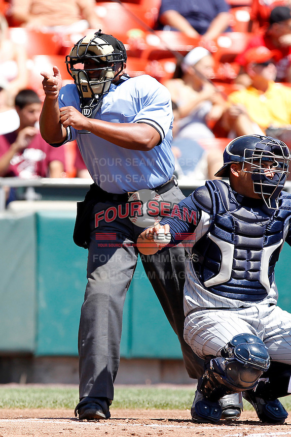Home plate Kelvin Bultron makes a call during a game between the Buffalo Bisons and Toledo Mudhens at Coca-Cola Field on August 17, 2011 in Buffalo, New York.  Buffalo defeated Toledo 4-2.  (Mike Janes/Four Seam Images)