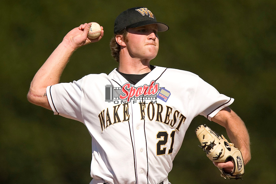 """You can see the scar on the right elbow of Wake Forest pitcher Justin Keadle (#21) as he faces North Carolina at Gene Hooks Stadium in Winston-Salem, NC, Friday, March 10, 2006.  Keadle missed the 2005 season after having """"Tommy John"""" surgery on his right elbow."""