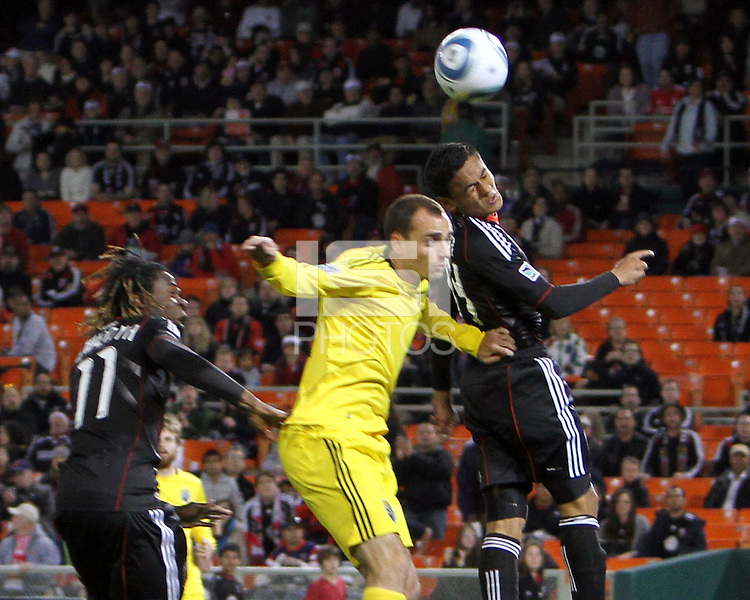 Andy Najar#14 of D.C. United heads over Rich Balchan#2 of the Columbus Crew during the opening match of the 2011 season at RFK Stadium, in Washington D.C. on March 19 2011.D.C. United won 3-1.