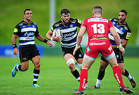 Guy Mercer of Bath Rugby takes on the Scarlets defence. Pre-season friendly match, between the Scarlets and Bath Rugby on August 20, 2016 at Eirias Park in Colwyn Bay, Wales. Photo by: Patrick Khachfe / Onside Images