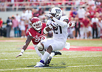 TCU Horned Frogs vs Arkansas Razorbacks –Reid Miller (38) of the Razorbacks brings down Noah Daniels (21) of the Horned Frogs at Donald W. Reynolds Razorback Stadium, University of Arkansas,  Fayetteville, AR, on Saturday, September 9, 2017,  © 2017 David Beach