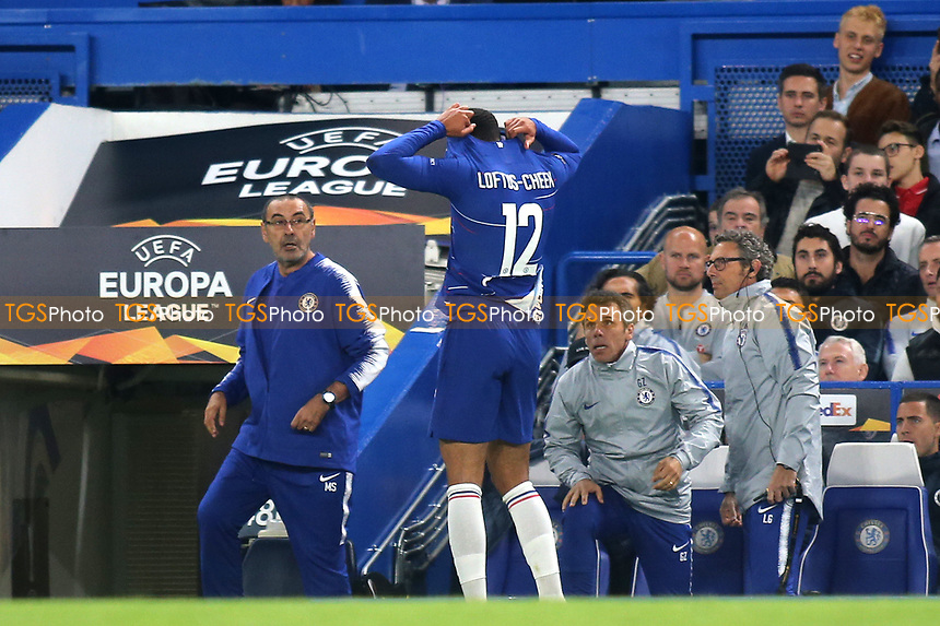 Chelsea's Ruben Loftus-Cheek walks over to change his torn shirt much to the surprise of Chelsea Manager, Maurizio Sarri and Gianfranco Zola during Chelsea vs MOL Vidi, UEFA Europa League Football at Stamford Bridge on 4th October 2018