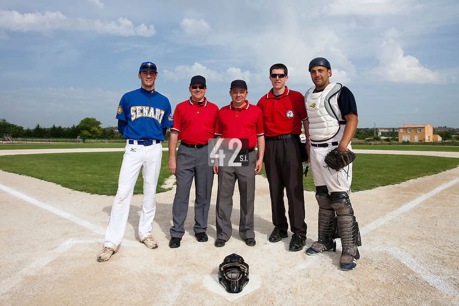 22 May 2009: Umpires pose next to Matthieu Brelle Andrade of Senart and Jean-Michel Mayeur of Montpellier during the 2009 challenge de France, a tournament with the best French baseball teams - all eight elite league clubs - to determine a spot in the European Cup next year, at Montpellier, France. Senart wins 7-1 over Montpellier.