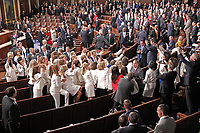 Democratic women wearing white in response to Representative Lois Frankel's call to acknowledge the voters who handed Democrats a majority in the House in the midterm elections and a reminder that they plan to make women's economic security a priority prior to US President Donald J. Trump delivers his second annual State of the Union Address to a joint session of the US Congress in the US Capitol in Washington, DC on Tuesday, February 5, 2019.<br /> CAP/MPI/RS<br /> &copy;RS/MPI/Capital Pictures