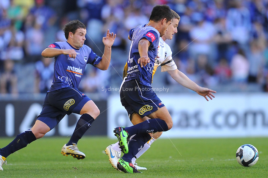 MELBOURNE, AUSTRALIA - JANUARY 26, 2010: Rodrigo Vargas from Melbourne Victory fights for the ball in round 19 of the A-league match between Melbourne Victory and Wellington Phoenix FC at Etihad Stadium on January 26, 2010 in Melbourne, Australia. Photo Sydney Low www.syd-low.com