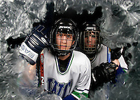 Seen through ice covered glass Sehome freshman Shawn Pauly, 14, left, and Ferndale freshman Jacob Grimm, 15, right, are both forwards for the West Coast Hockey Club and will be representing the state of Washington at the 2007 USA National Ice Hockey Championship Tournament in the Youth Division in Buffalo, NY next week...032207 CS Hockey01 NJD/CJT.**SPORTS**.BELLINGHAM HERALD PHOTO BY NIKI DESAUTELS