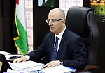 Palestinian Prime Minister Rami Hamdallah chairs a meeting of council of Ministers in the West Bank city of Ramallah on May 15, 2018. Photo by Prime Minister Office