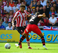Lincoln City's Bruno Andrade vies for possession with Swindon Town's Kyle Knoyle<br /> <br /> Photographer Andrew Vaughan/CameraSport<br /> <br /> The EFL Sky Bet League Two - Lincoln City v Swindon Town - Saturday August 11th 2018 - Sincil Bank - Lincoln<br /> <br /> World Copyright &copy; 2018 CameraSport. All rights reserved. 43 Linden Ave. Countesthorpe. Leicester. England. LE8 5PG - Tel: +44 (0) 116 277 4147 - admin@camerasport.com - www.camerasport.com