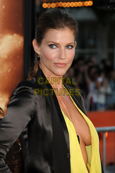 Tricia Helfer<br /> &quot;Riddick&quot; Los Angeles Premiere held at the Regency Village Theatre, Westwood, California, USA,<br /> August 28th 2013.<br /> headshot portrait suit black blazer jacket top yellow plunging neckline cleavage necklace half length<br /> CAP/ADM/BP<br /> &copy;Byron Purvis/AdMedia/Capital Pictures