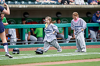 Two young kids take part in a promotional event during a game between the Columbus Clippers and the Gwinnett Stripers on May 17, 2018 at Huntington Park in Columbus, Ohio.  Gwinnett defeated Columbus 6-0.  (Mike Janes/Four Seam Images)