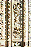 close up of Gothic bas-relief sculptures on the facade of  the Gothic-Renaissance Duomo of Florence,  Basilica of Saint Mary of the Flower; Firenza ( Basilica di Santa Maria del Fiore ).  Built between 1293 & 1436. Italy