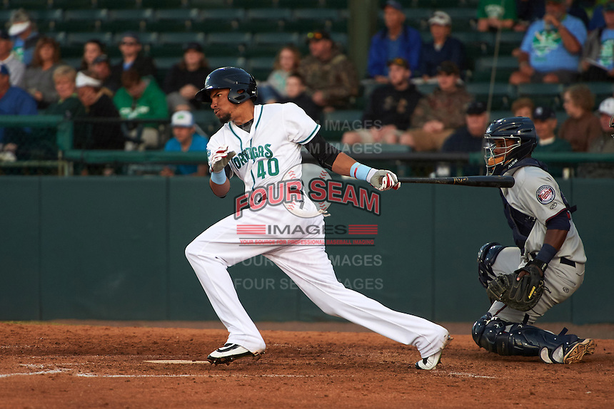 Daytona Tortugas center fielder Jonathan Reynoso (40) at bat in front catcher Brian Navarreto (23) during a game against the Fort Myers Miracle on April 17, 2016 at Jackie Robinson Ballpark in Daytona, Florida.  Fort Myers defeated Daytona 9-0.  (Mike Janes/Four Seam Images)
