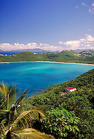 Magens Bay with palm trees in foreground with red roof. St. Thomas, US Virgin Islands Caribbean.