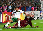 21 June 2006: Paulo Ferreira (POR) (2) slides through Omar Bravo (MEX). Portugal defeated Mexico 2-1 at Veltins Arena in Gelsenkirchen, Germany in match 31, a Group D first round game, of the 2006 FIFA World Cup.