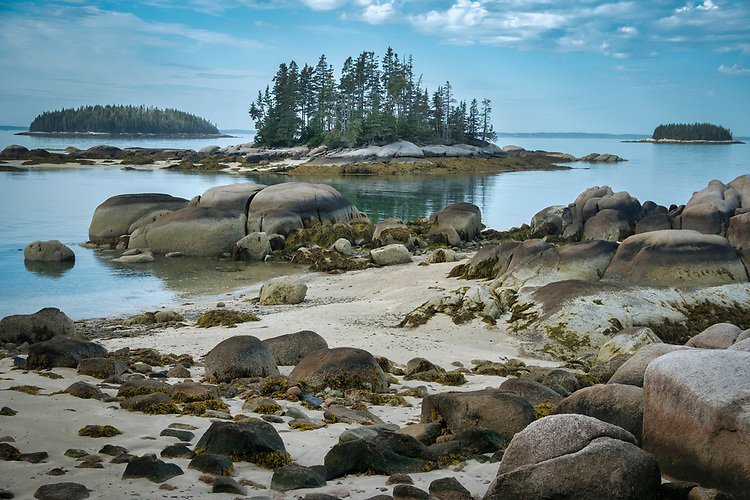Just outside of Stonington, Maine lies this tranquil, boulder-filled sandy beach fronting on Penobscot Bay.