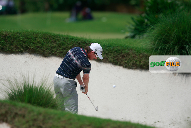 Brett Rumford (AUS) plays his 2nd shot from a bunker on the 10th hole during Thursday's Round 1 of the 2011 Iskandar Johor Open, Horizon Hills Golf Club, Johor, Malaysia, 15th November 2011 (Photo Eoin Clarke/www.golffile.ie)