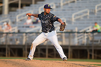 Yordi Calderon (19) of the Everett Aquasox delivers a pitch during a game against the Hillsboro Hops at Everett Memorial Stadium in Everett, Washington on July 5, 2015.  Hillsboro defeated Everett 11-4. (Ronnie Allen/Four Seam Images)