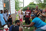 Neighbors of Michael Jackson's boyhood home gather shortly after he passed away at a Los Angeles hospital outside the home at 2300 Jackson Street in Gary, Indiana on June 25, 2009.