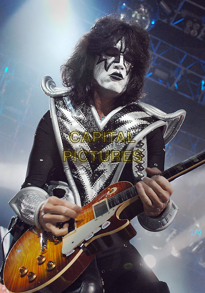 "TOMMY THAYER of the legendary rock band KISS .Perform as part of the ""Alive 35 Tour"" held at the Mellon Arena, Pittsburgh, Pennsylvania, USA.             .December 13th, 2009                .stage concert live gig performance music silver costumes black white faces painted guitar silver guitar paint half length .CAP/ADM/DS.©Devin Simmons/AdMedia/Capital Pictures."