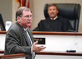 Prince William County (Virginia) Assistant Commonwealth attorney Richard S. Conway delivers the opening remarks in the penalty phase of the trial of sniper suspect John Allen Muhammad as judge LeRoy Millette, Jr., background, looks on in courtroom 10 at the Virginia Beach Circuit Court in Virginia Beach, Virginia on November 17, 2003.  Muhammad was found guilty of capital murder, terrorism, conspiracy and a firearms violation. <br /> Credit: Dave Ellis - Pool via CNP