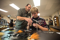 NWA Democrat-Gazette/J.T. WAMPLER Matt Barber(left) gets a lesson in tying flys Wednesday Nov. 4, 2015 from Gary Rowland with Bella Vista Fly Tyers Club during the outdoor education class at Bentonville High School.  The students will use the flys later during a field trip.