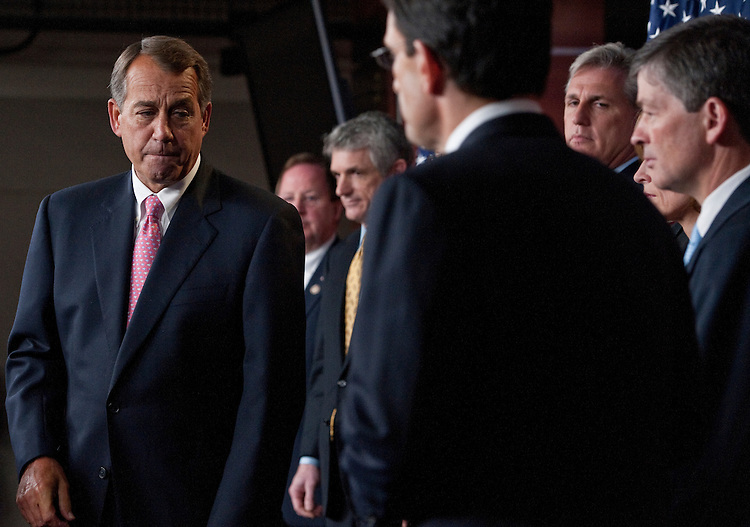 UNITED STATES - JUNE 16: Speaker of the House John Boehner, R-Ohio, left, turns the podium over to House Majority Leader Eric Cantor, R-Va., as other House Republicans look on during a news conference on Thursday, June 16, 2011. (Photo By Bill Clark/Roll Call)