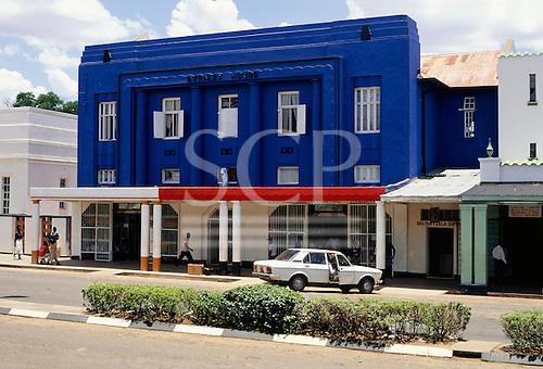 Livingstone, Victoria Falls, Zambia. Stanley House, an art deco style small office building painted dark blue.