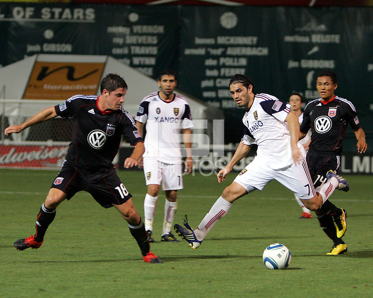 Devon McTavish #18 of D.C. United moves in to tackle Fabian Espindola #7  of Real Salt Lake during an Open Cup match at RFK Stadium, on June 2 2010 in Washington DC. DC United won 2-1.