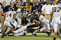 26 December 2010:  FIU linebacker Toronto Smith (13) stops a Toledo ball carrier in the second half as the FIU Golden Panthers defeated the University of Toledo Rockets, 34-32, to win the 2010 Little Caesars Pizza Bowl at Ford Field in Detroit, Michigan.