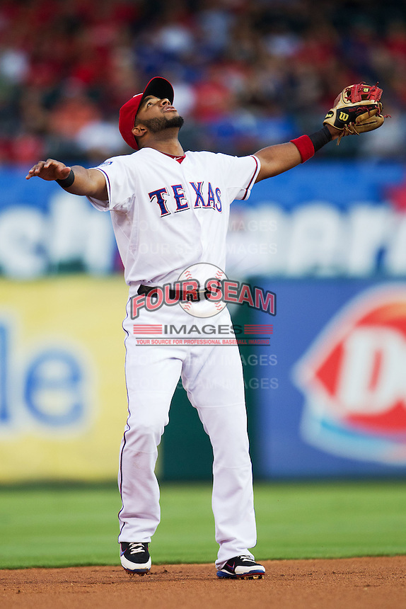 Texas Rangers shortstop Elvis Andrus #1 calls for a pop up during the Major League Baseball game against the Baltimore Orioles on August 21st, 2012 at the Rangers Ballpark in Arlington, Texas. The Orioles defeated the Rangers 5-3. (Andrew Woolley/Four Seam Images).