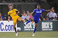 Kyle Beckerman (yellow), Teal Bunbury...Kansas City Wizards and Real Salt Lake played to a 1-1 tie at Community America Ballpark, Kansas City, Kansas.