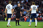 Michael Dean is confronted by Harry Kane of Tottenham Hotspur and Eric Dier of Tottenham Hotspur during the premier league match at the Wembley Stadium, London. Picture date 16th September 2017. Picture credit should read: Robin Parker/Sportimage