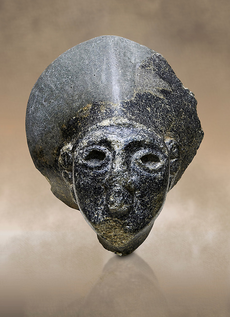 Hittite statue head of the Sun Goddess . Basalt, Hittie Period 1650 - 1450 BC. Hattusa Boğazkale. Çorum Archaeological Museum, Corum, Turkey. Against a warm art bacground.