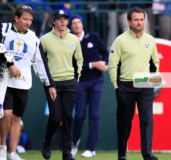 Europe's Graeme McDowell and Rory McIlroy (NIR) walk off the 1st tee during Friday's Morning Foursomes Matches of the 39th Ryder Cup at Medinah Country Club, Chicago, Illinois 28th September 2012 (Photo Eoin Clarke/www.golffile.ie)