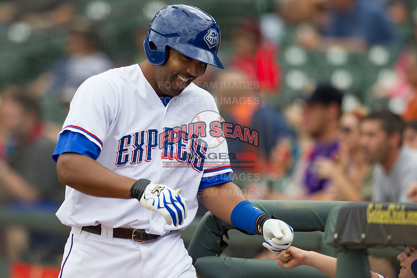 Round Rock Express outfielder Joey Butler #16 smiles as he returns to the dugout after homering against the New Orleans Zephyrs in the Pacific Coast League baseball game on April 21, 2013 at the Dell Diamond in Round Rock, Texas. Round Rock defeated New Orleans 7-1. (Andrew Woolley/Four Seam Images).